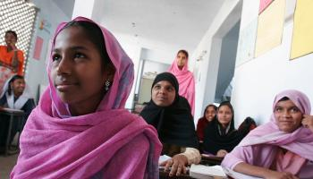 Girls in a Madrasa are provided with formal education under a USAID-supported program